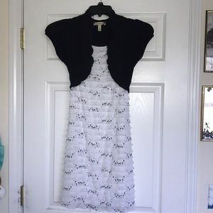 white ruffle dress with black cardigan attached